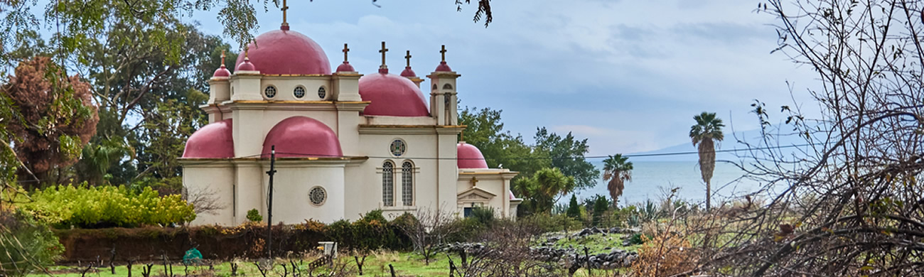 Church of the 12 Apostles on the background of the Sea of Galilee - Capernaum, Israel