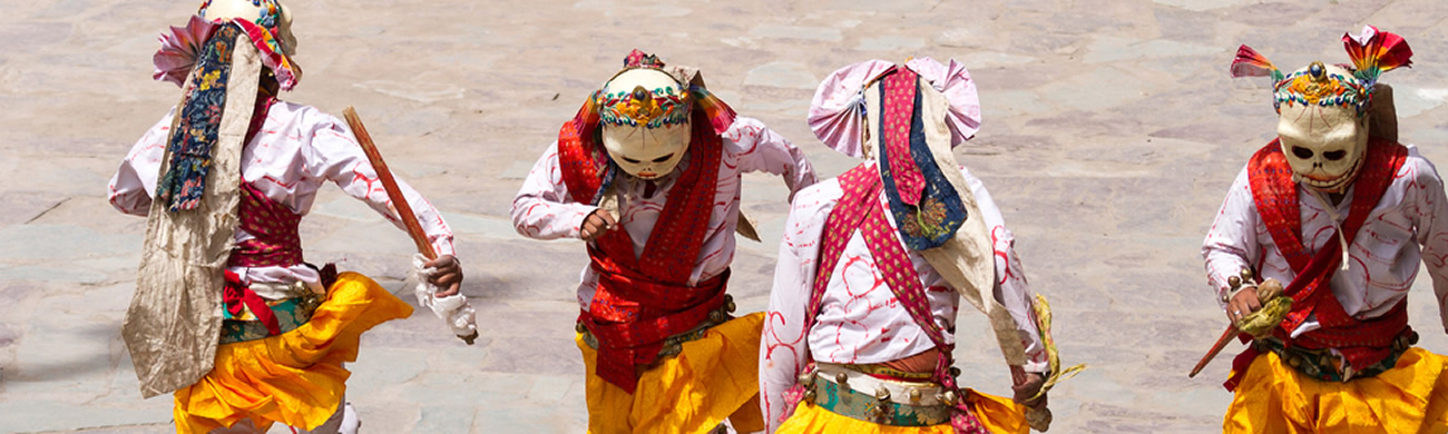 Monks performing a religious masked and costumed mystery dance of Tibetan Buddhism - Hemis Monastery, India.