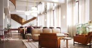Hu Hotel, Memphis, TN lobby with a wall of windows, white paint and tan furnishings