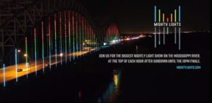 An Ad for the Mighty Lights Show, Memphis, TN.  A multi-colored bridge lit in the night.