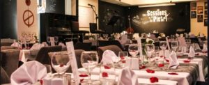 """Rabat's Le Bistrot du Pietri. Chic dining room with """"Sessions du Pietri"""" painted in white letters on a black walled stage"""