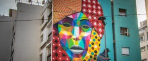 """Four story mural of a woman's face, painted in a kaleidoscope of colors to celebrate the """"Afrique en Capitale"""" in Rabat"""