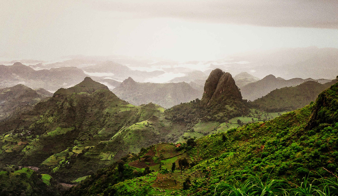 Simien Mountains in Northern Ethiopia. Green majestic mountains that fade into misty craggy cliffs in the distance