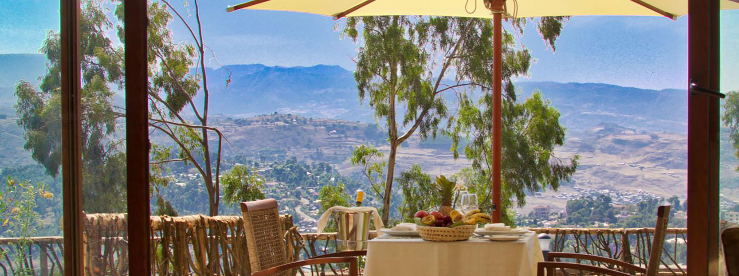 Gondar Hills Hotel dining on the terrace with sweeping panoramic views of Gondar, Ethiopia