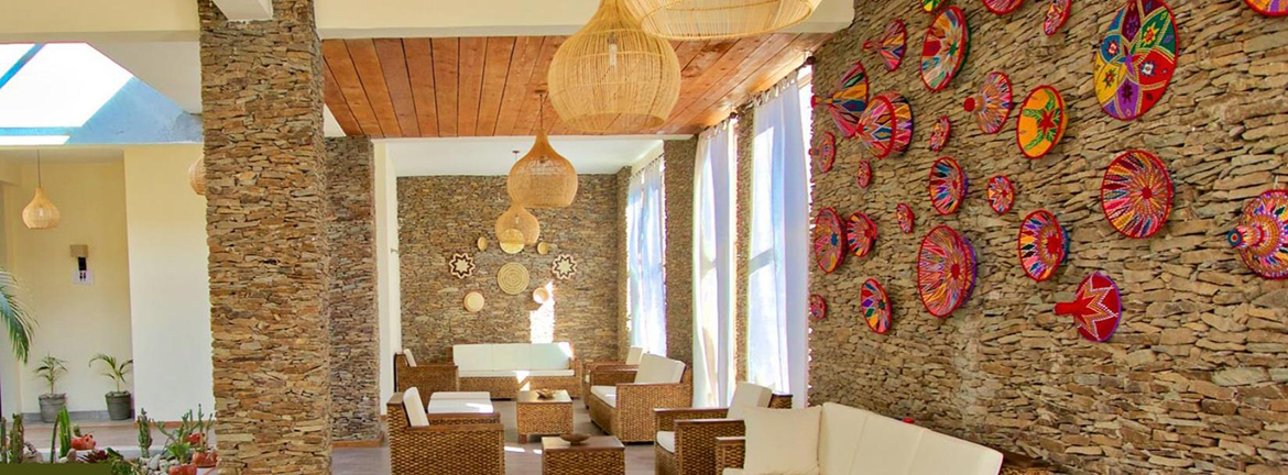 An earth toned, light and airy lobby of the Gondar Hills Hotel in Gondar, Ethiopia.