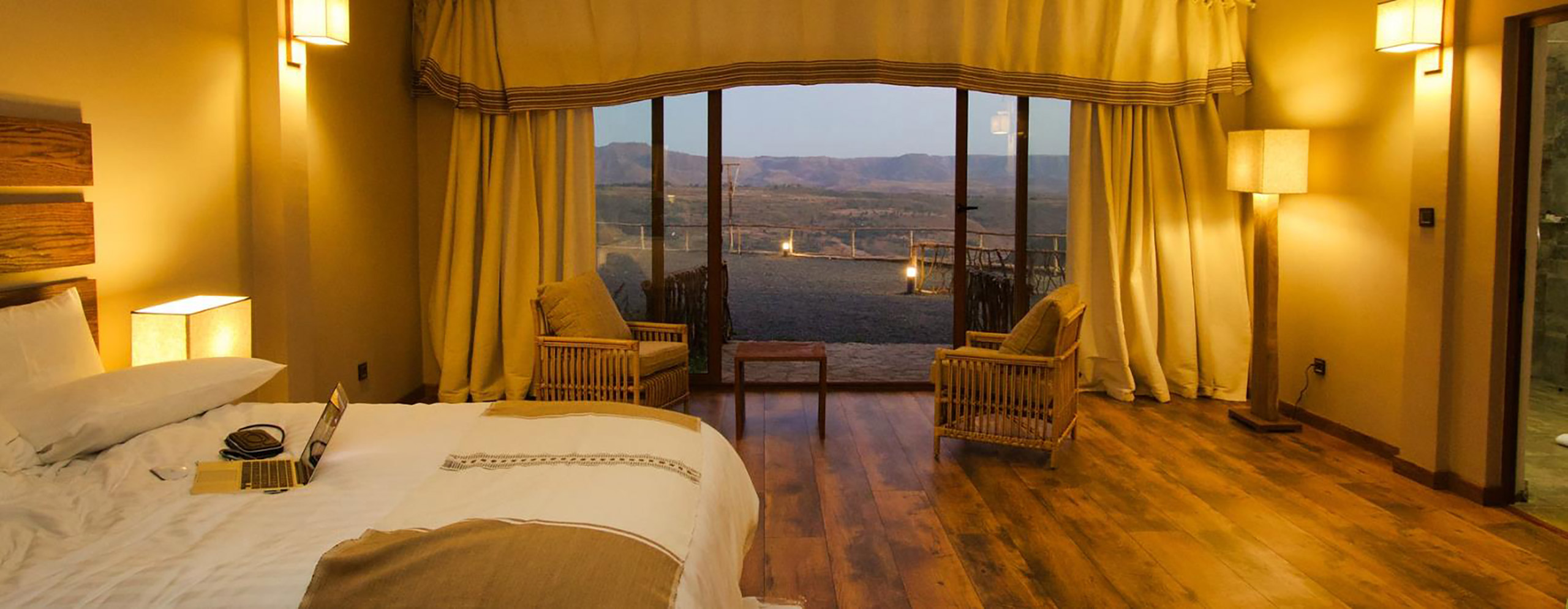 Room at Gondar Hills Hotel with a spectacular view of Gondar Ethiopia through the wall to wall windows.