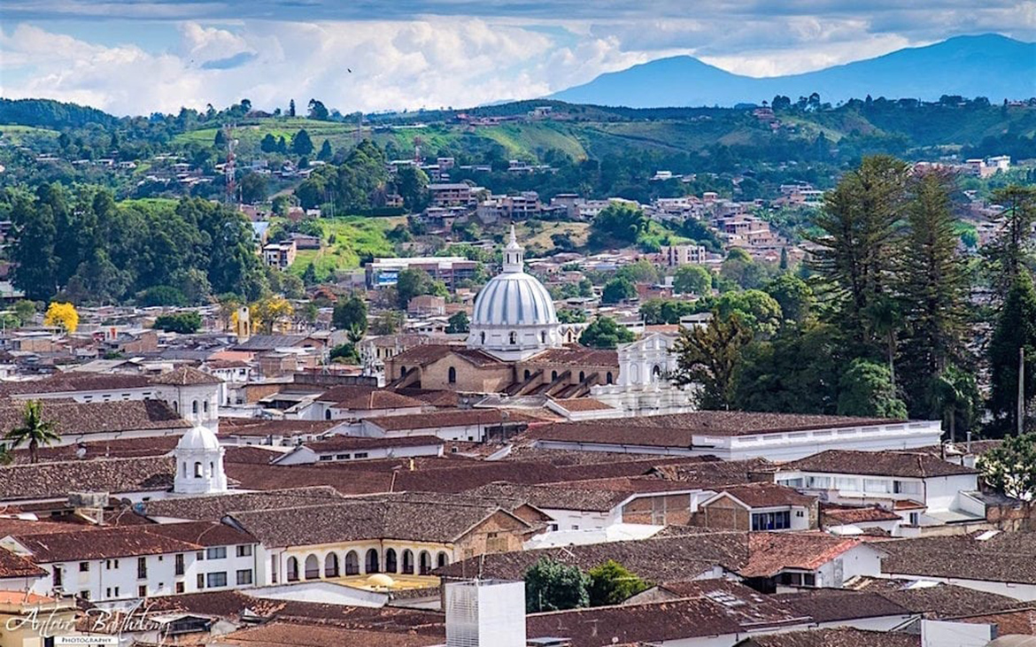 The cityscape of Popayan with the city's white domed cathedral in the middle