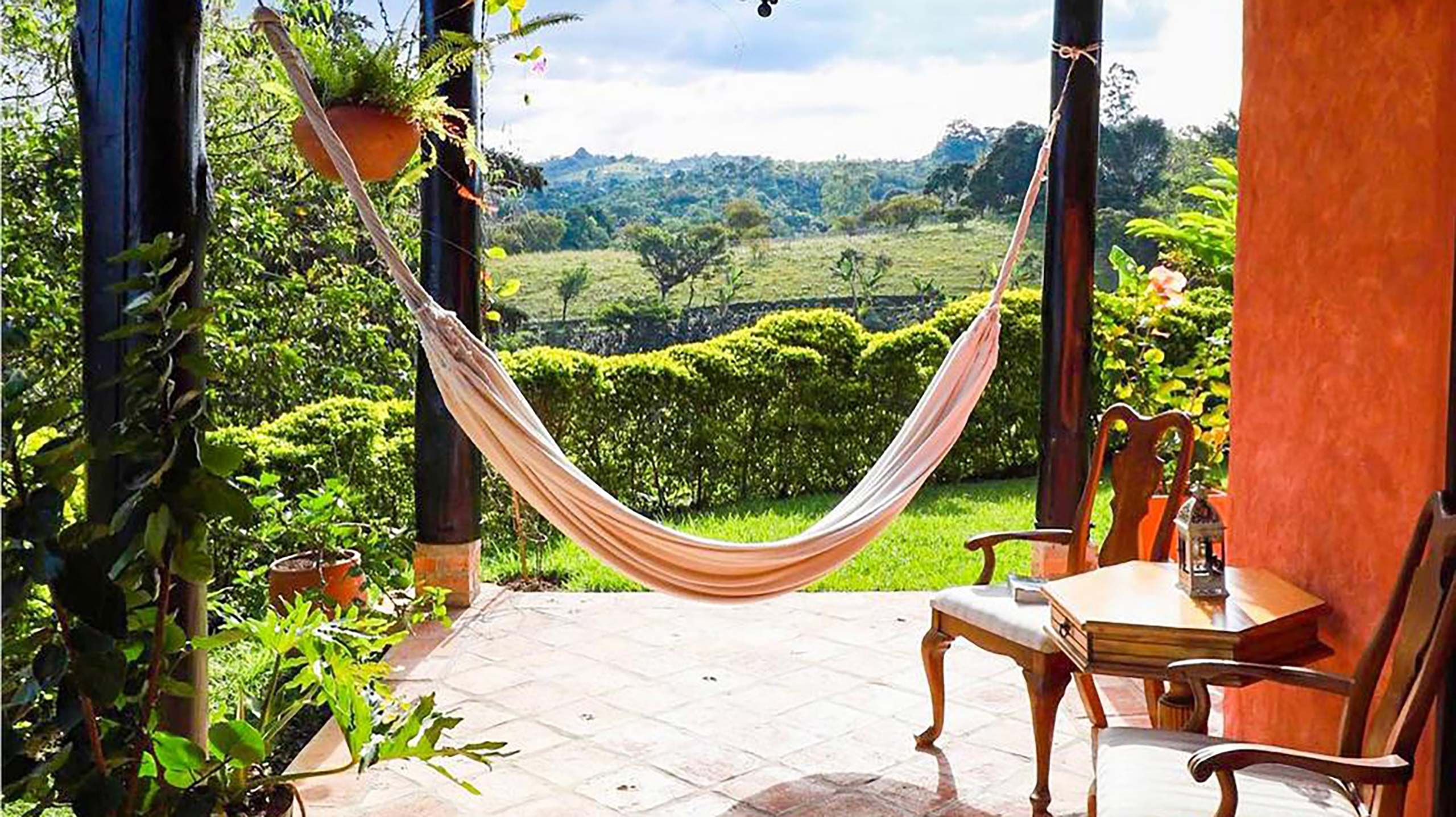 Along the hotel a hammock with a beautiful views of luscious green country side.
